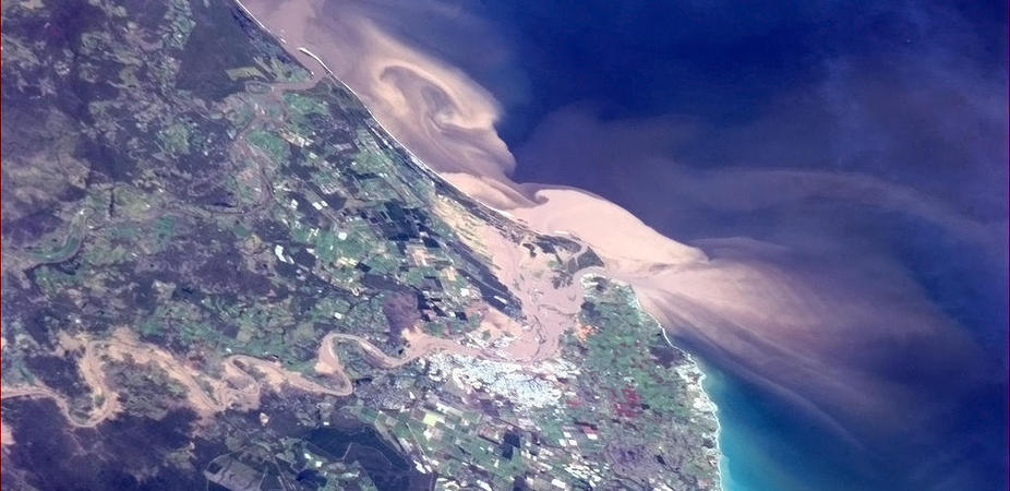 Incidents of major agricultural run-off, like the recent Queensland floods, certainly affect Great Barrier Reef water quality, but systems are in place to reduce their effect. AAP Image/Twitter, ISS, Chris Hadfield